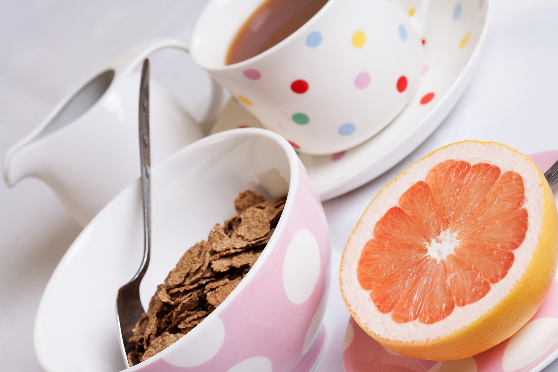 Nutritious Breakfast with cereal, orange, coffee