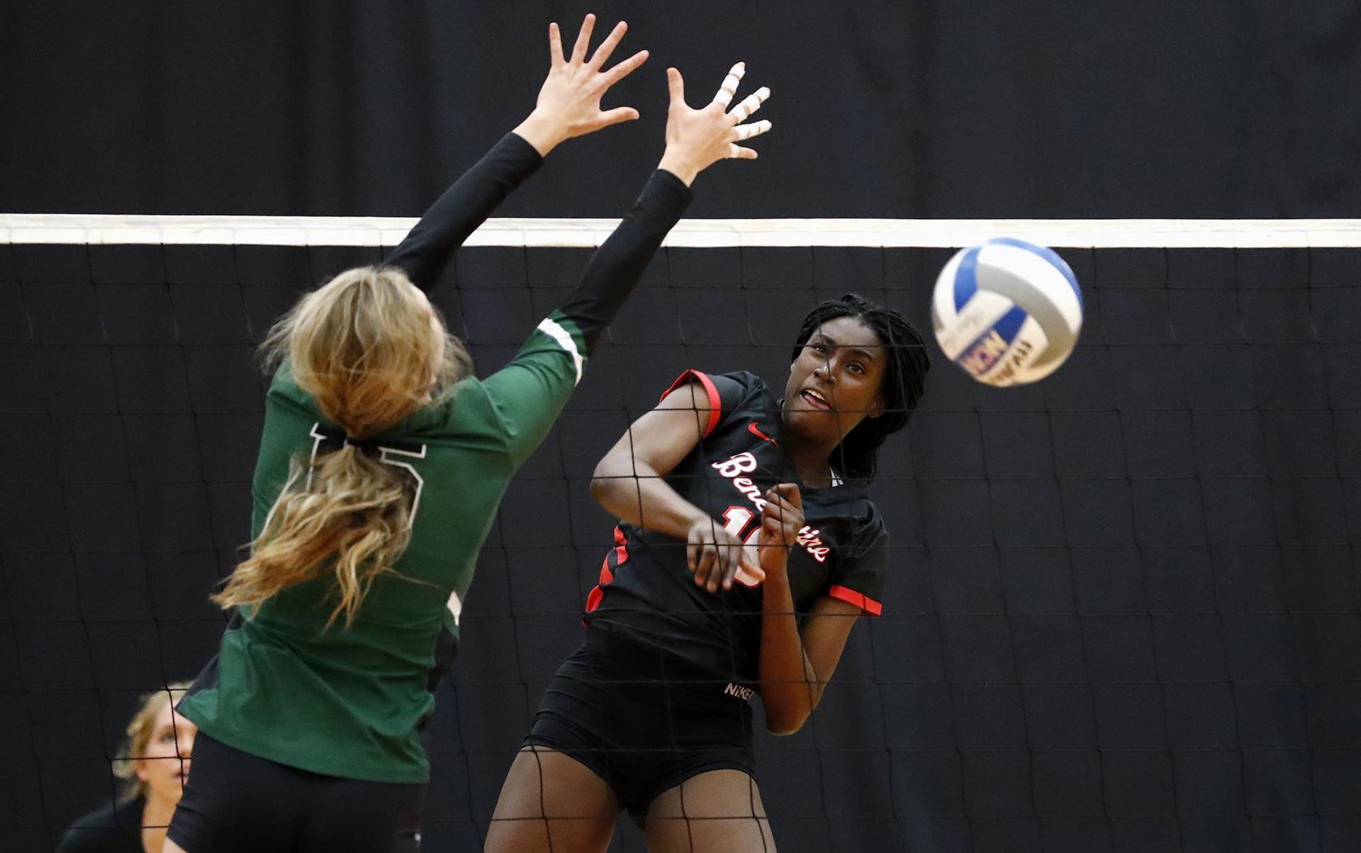 BenU Volleyball player getting a kill